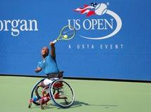 O jogador de tênis Lucas Sithole de África do Sul durante o quadrilátero 2014 da cadeira de rodas do US Open escolhe o fósforo imagens de stock royalty free