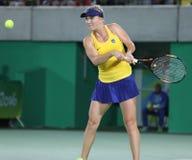 O jogador de tênis profissional Elina Svitolina de Ucrânia na ação durante escolhe em volta do fósforo três do Rio 2016 Jogos Olí Fotos de Stock