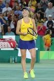 O jogador de tênis profissional Elina Svitolina de Ucrânia na ação durante escolhe em volta do fósforo três do Rio 2016 Jogos Olí Fotografia de Stock