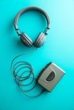 O jogador e os fones de ouvido audio do vintage imagem de stock royalty free