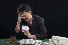O jogador usou uma mão fora da cara com o esforço Imagens de Stock Royalty Free
