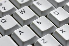 O jogo abotoa A W S D em um close-up branco do teclado para o gamer Fotografia de Stock