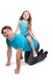 O jogo do pai e da filha cavalo-monta Fotografia de Stock