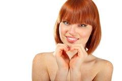 O jovem bonito da mulher faz o coração das mãos Imagem de Stock
