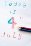 4o julho escrito Fotografia de Stock