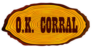 O.K. Corral Log Sign. A section of a sawn log with the words OK Coraal over a white background stock illustration