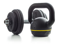 O kettlebell e o peso pretos Fotografia de Stock