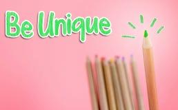 O lápis da cor verde cola para fora para original Imagens de Stock Royalty Free