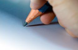 O lápis fecha-se à disposicão acima imagem de stock royalty free