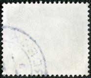 O lado reverso de um selo de porte postal Imagem de Stock Royalty Free