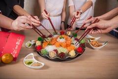 O lance asiático da prosperidade, Lohei, Yusheng, yee cantou fotos de stock royalty free