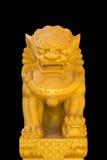 O leão chinês isolado no fundo preto Imagem de Stock
