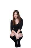 O levantamento fêmea bonito no estúdio vestiu-se no bodysuit 'sexy' Fotos de Stock
