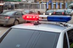 O lightbar telhado-montado do carro de polícia Fotografia de Stock Royalty Free