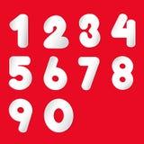 O Livro Branco cortou o número ajustado no fundo vermelho Imagens de Stock Royalty Free
