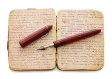 O livro de nota velho em um fundo branco Fotografia de Stock Royalty Free