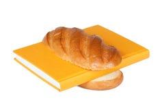 O livro e o pão Foto de Stock Royalty Free