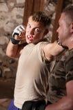 O lutador joga perfuradores Fotografia de Stock Royalty Free