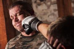 O lutador obtem perfurado Foto de Stock Royalty Free