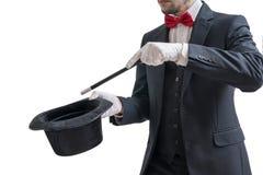 O mágico ou o ilusionista estão mostrando o truque mágico Isolado no fundo branco imagens de stock royalty free