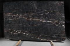 O mármore escuro com listras chamou Porto Laurent fotos de stock