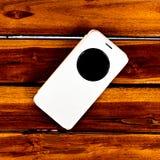 O móbil está na madeira fotografia de stock royalty free