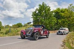 O M 665 SS milímetro Superba (1930) correm em Mille Miglia 2014 Foto de Stock