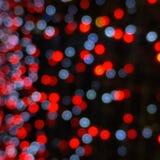 O macro borrado ilumina o vermelho e o cinza Fotos de Stock Royalty Free