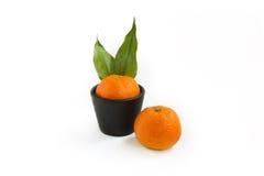 O mandarino na cubeta imagem de stock royalty free