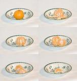 O mandarino que está sendo comido Imagens de Stock Royalty Free