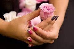O Manicure com levantou-se fotos de stock