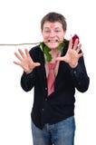 O mantimento engraçado do homem levantou-se em sua boca Imagem de Stock Royalty Free
