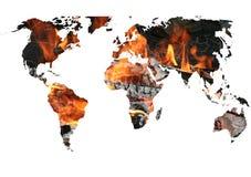O mapa de mundo no incêndio imagens de stock royalty free