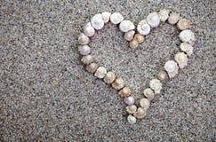 O mar descasca o coração Fotografia de Stock
