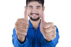 O mecânico novo mostra dois polegares acima Imagem de Stock Royalty Free
