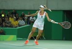 O medalhista de prata olímpico Angelique Kerber de Alemanha na ação durante mulheres do tênis escolhe o final Foto de Stock Royalty Free