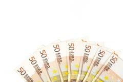 O meio círculo fez com euro- dinheiro europeu das cédulas 50 no fundo branco Fotografia de Stock Royalty Free