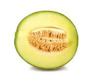 O melão, melão cortou a parte no fundo branco Fotos de Stock