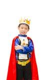 O menino é vestido no terno de um príncipe fotografia de stock royalty free