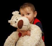 O menino abraça o brinquedo Imagem de Stock