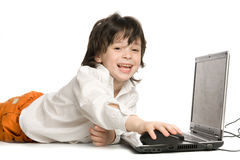 O menino alegre com portátil imagens de stock royalty free