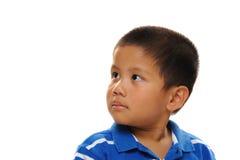 O menino asiático olha feliz Imagem de Stock Royalty Free