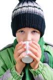 O menino bebe o chá Fotografia de Stock