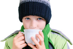 O menino bebe o chá fotografia de stock royalty free