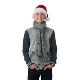 O menino bonito do adolescente na camiseta cinzenta sobre o branco isolou o fundo Fotografia de Stock Royalty Free