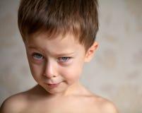 O menino bonito está completo das emoções Foto de Stock Royalty Free