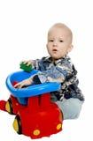 O menino com máquina do brinquedo Fotografia de Stock Royalty Free
