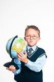O menino com o globo Fotos de Stock Royalty Free