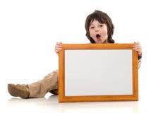 O menino com um frame imagem de stock royalty free