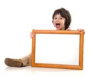 O menino com um frame fotos de stock